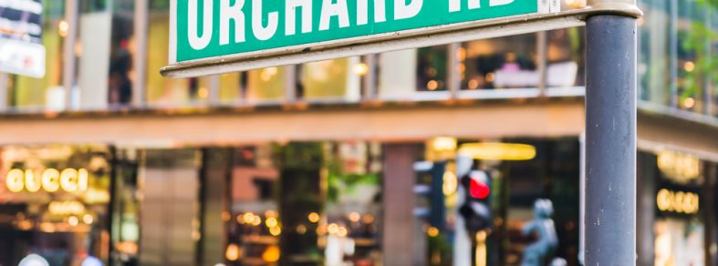 """A signboard showing """"Orchard Road""""."""