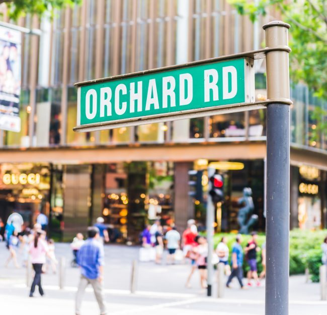 "A signboard showing ""Orchard Road""."