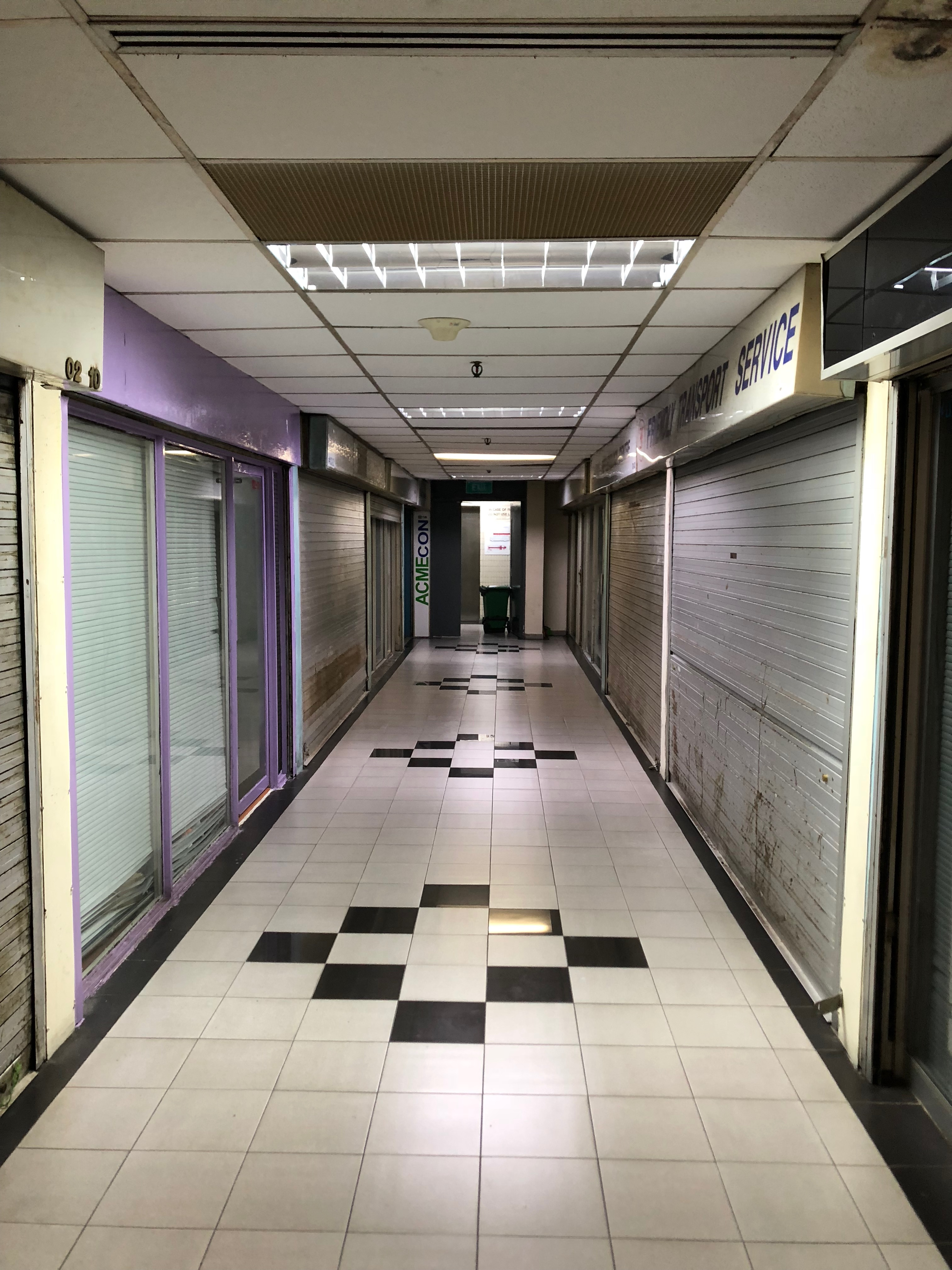 Empty shop units in Ming Arcade.