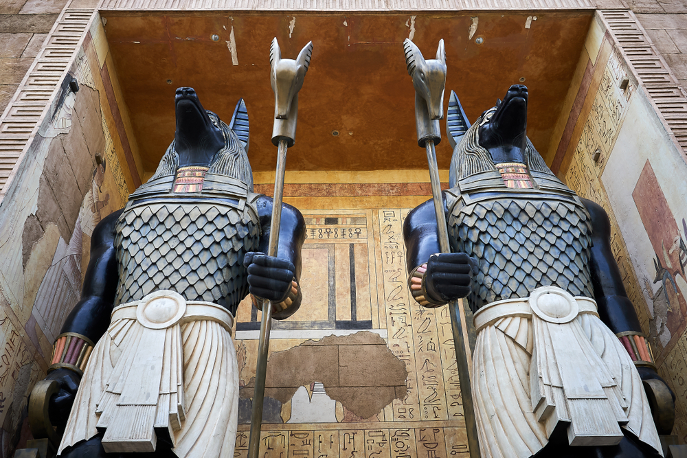 Two tall Egyptians god Anubis statues.