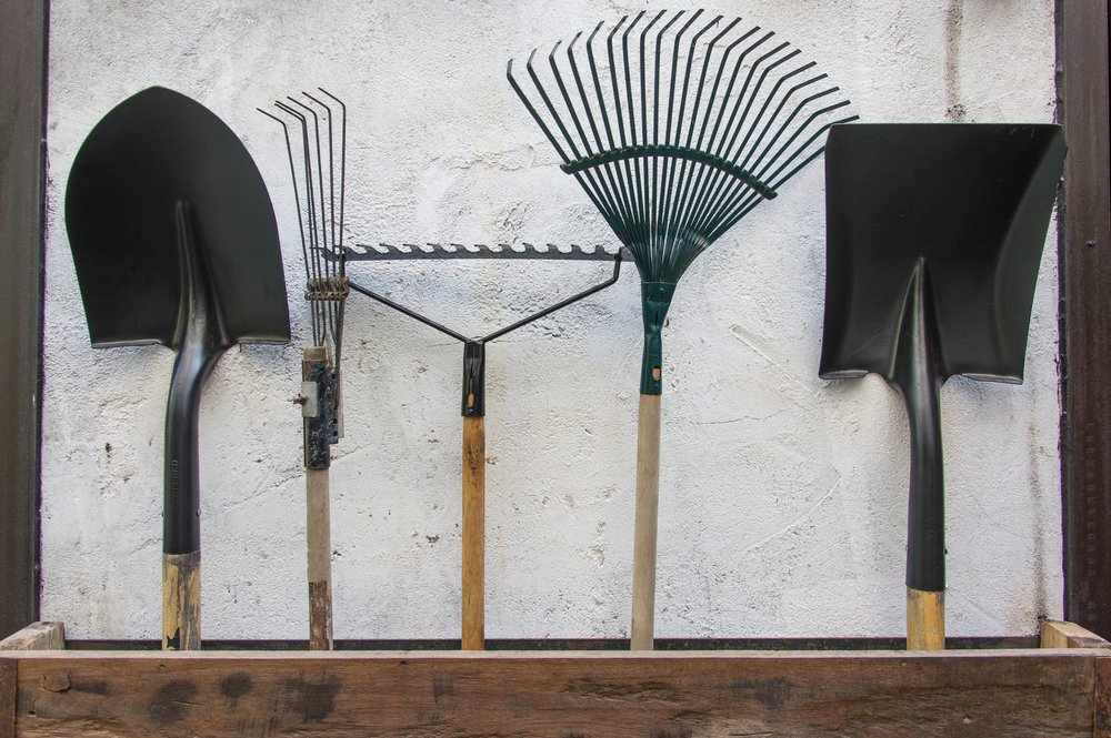 Five different types of gardening tools such as a shovel.