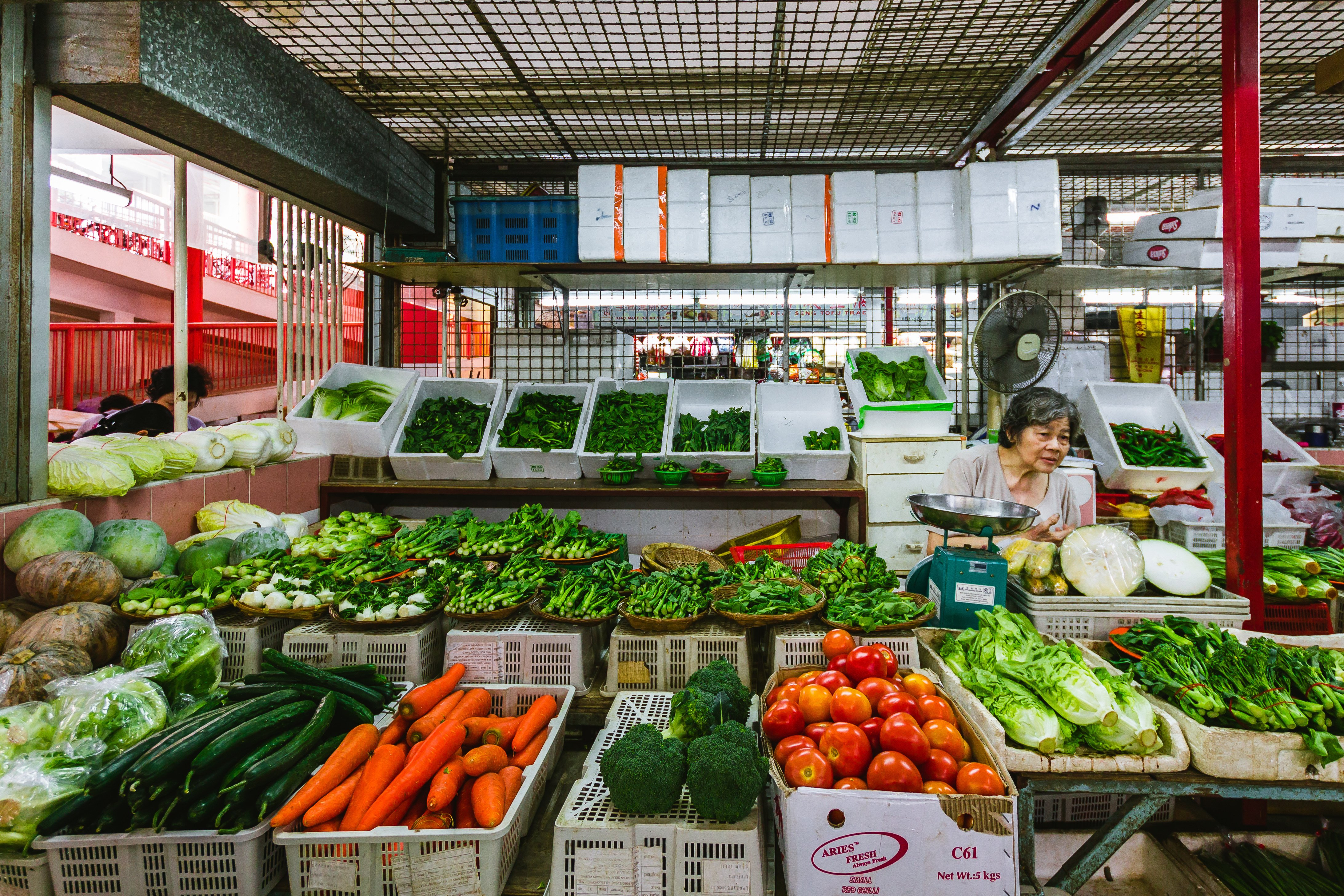 wet market stall in chinatown selling fresh vegetables