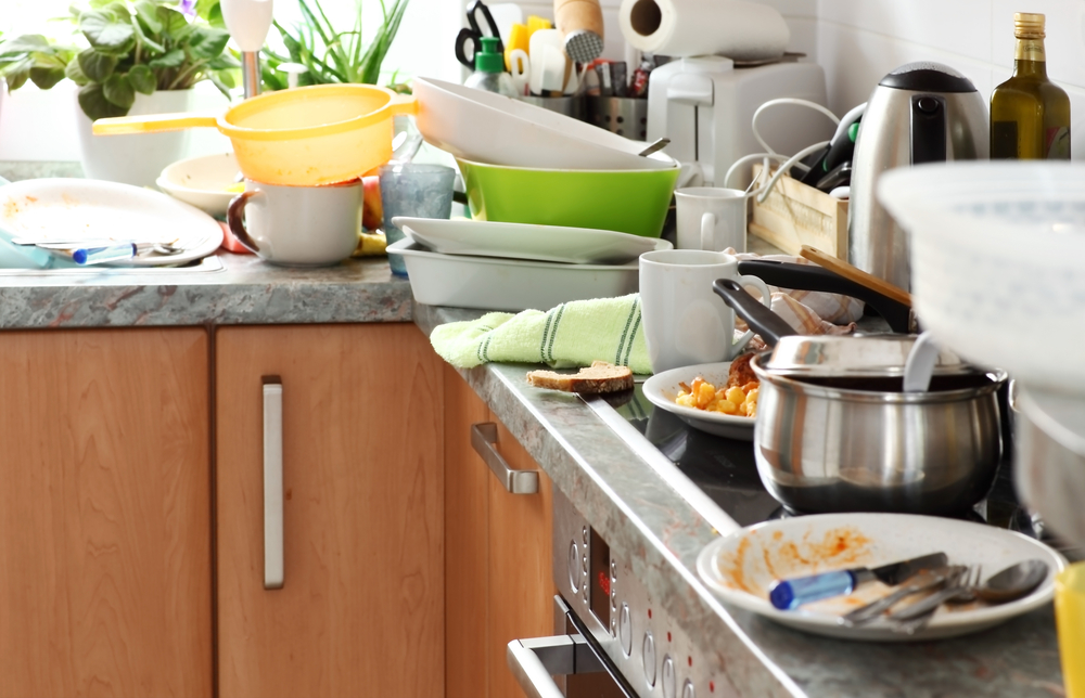 dishes stacked up in the sink