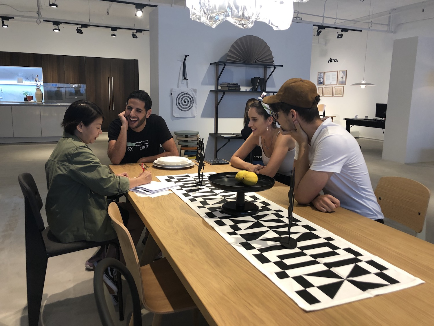 nas daily team checking out home office furniture at vitra