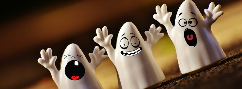 Three plastic ghost toys