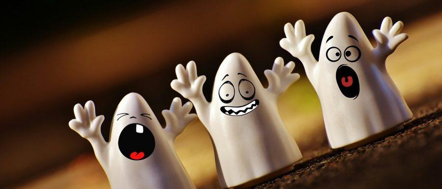 Three plastic ghost toys