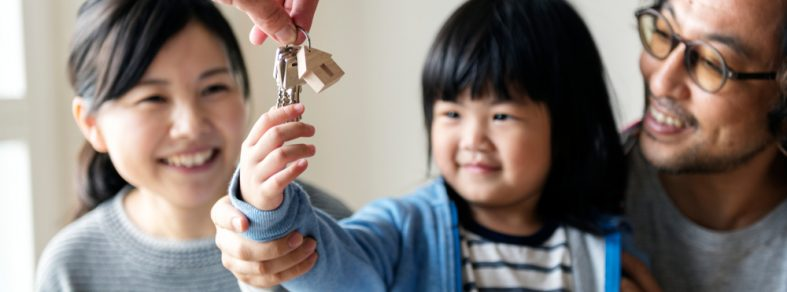 A girl receiving keys to the new home