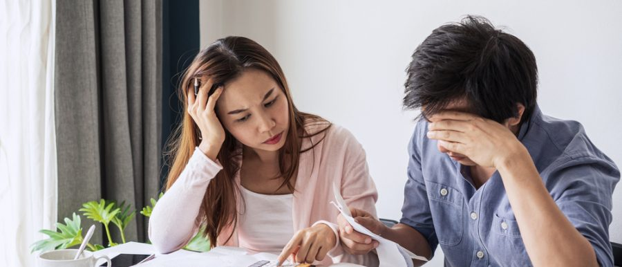 a couple stressed over finances and housing affordability