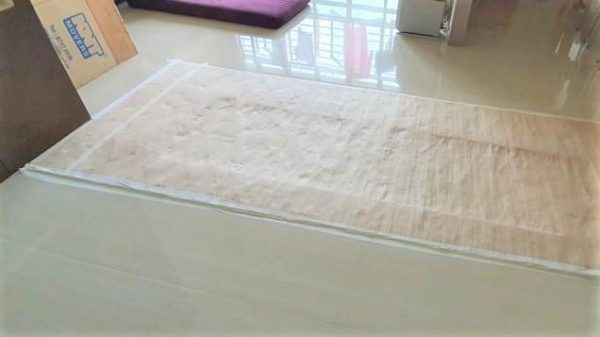 A protective sheet covering the area that had dislodged tiles