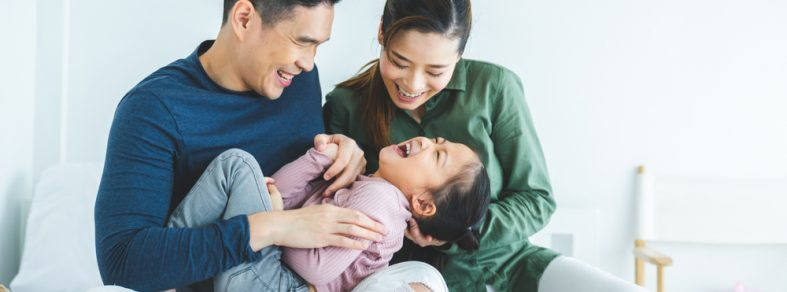 A couple playing with daughter