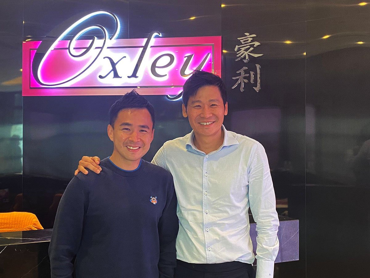 Eugene Lim and deputy CEO Oxley Eric Low