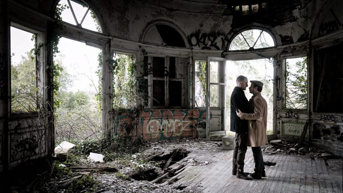 Middle age gay LGBTQ couple in an abandoned house