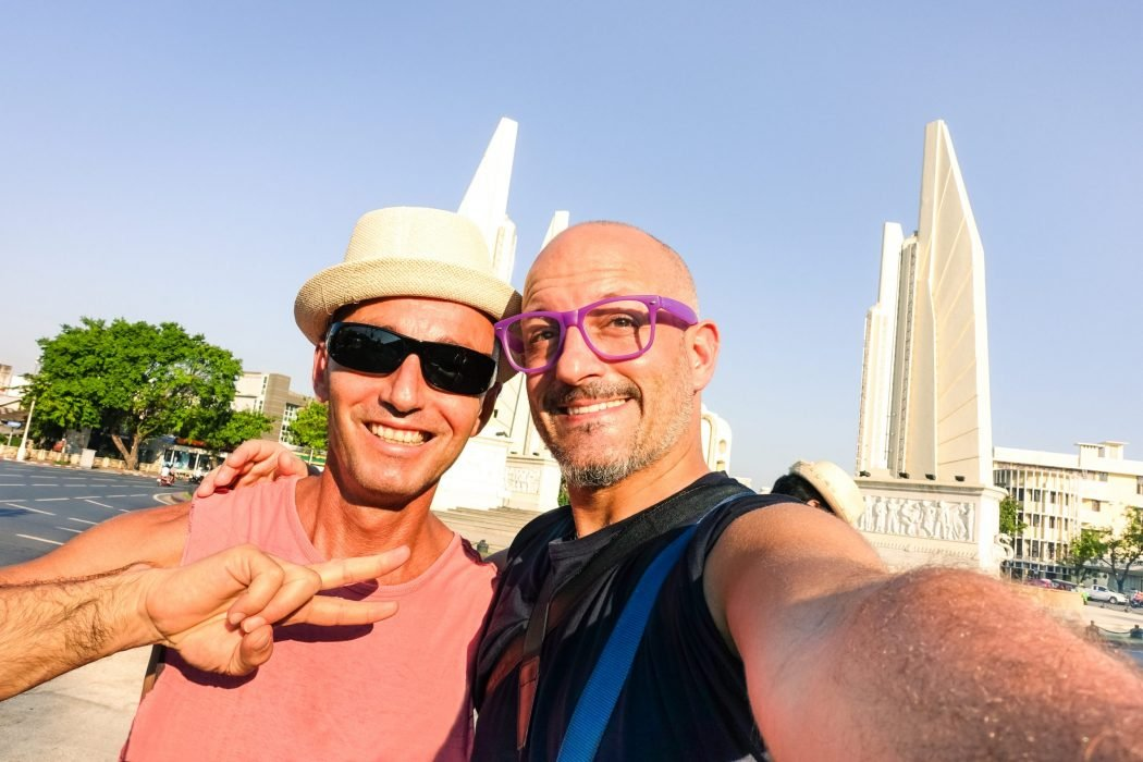 Happy,Couple,Of,Male,Friends,Taking,Selfie,At,Bangkok,Democracy